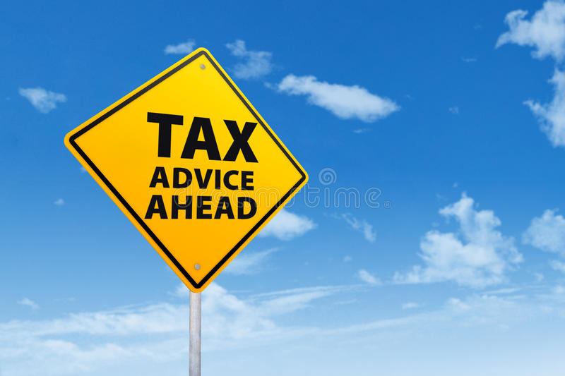 Tax advice concept. With sign post under blue sky stock image