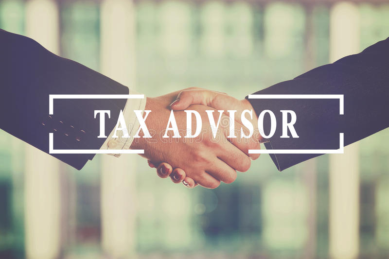 Tax advisor. Businesspeople handshake. Tax advisor, finance concept. Added retro filter royalty free stock image