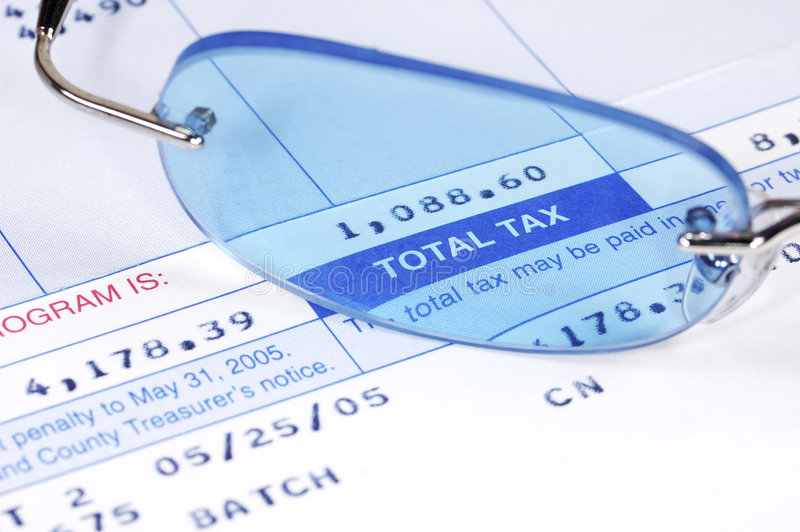 Tax Bill. Eyeglasses on a tax Bill