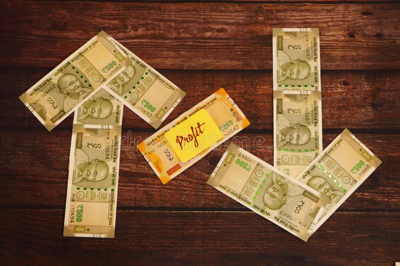 Profit concept. Indian Currency showing ups and down. Tax concept. Indian Currency showing ups and down of profit royalty free stock images