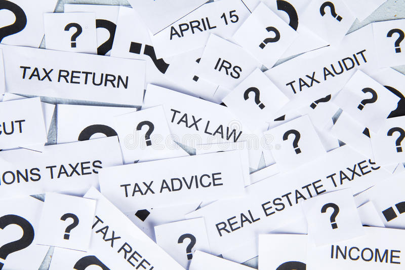 Tax concept. With text of tax and question mark royalty free stock photo