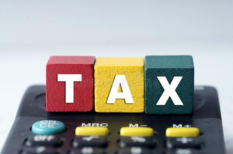 Tax Concept with tax word on calculator royalty free stock photo
