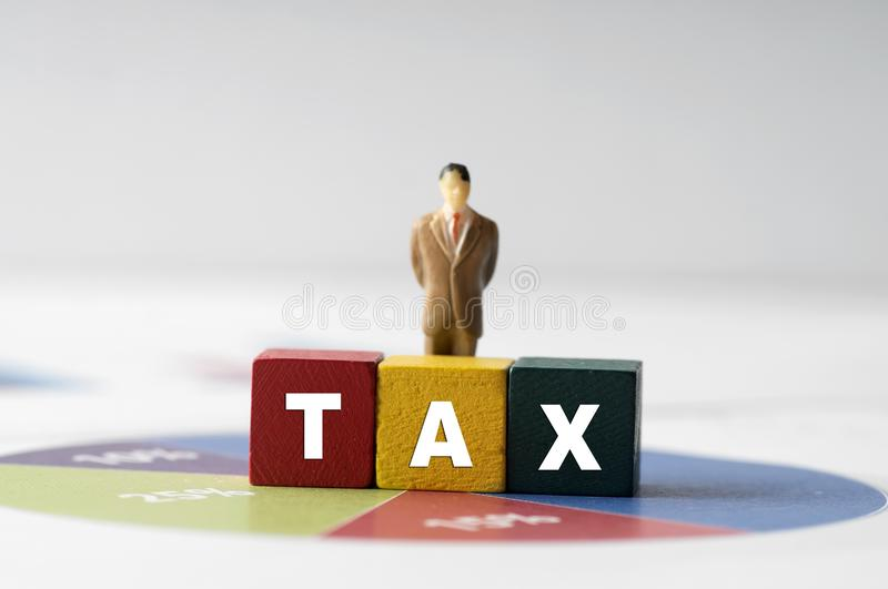 Tax Concept with tax word on wooden block stock images