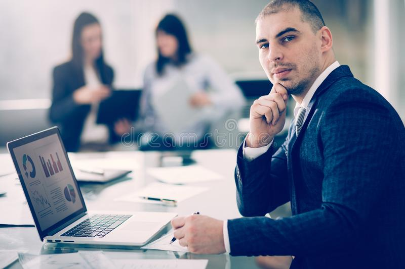 Tax consultant works with financial charts at the workplace. In the office stock photo