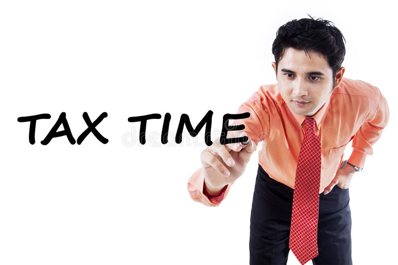 Tax consultant writes tax time. Young tax consultant writes a text of tax time on the whiteboard to remind the time for paying tax stock image