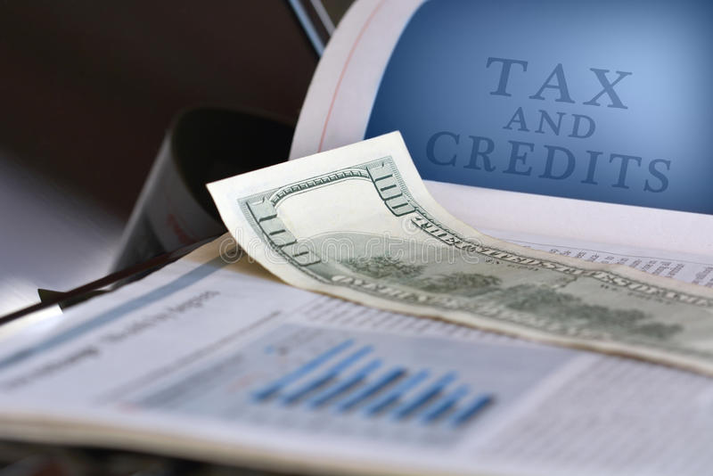Tax and credits concept. Calculator, glasses and black pen on financial documents stock image