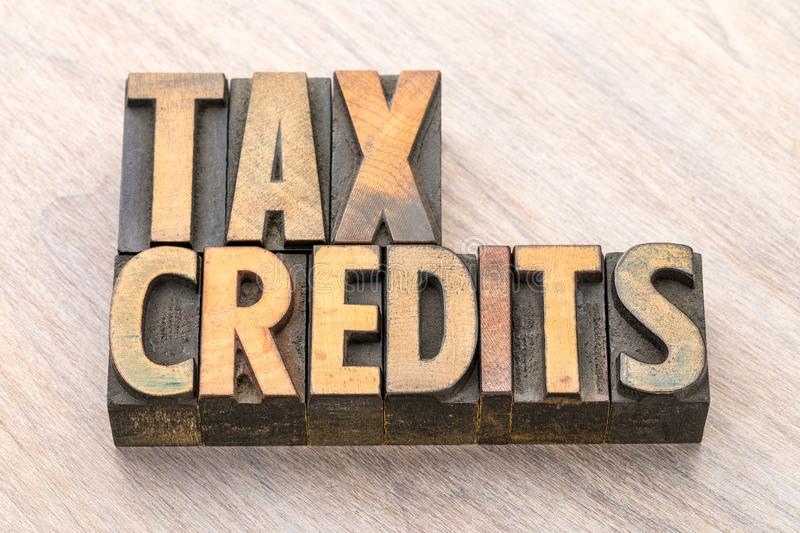 Tax credits word abstract in wood type royalty free stock image