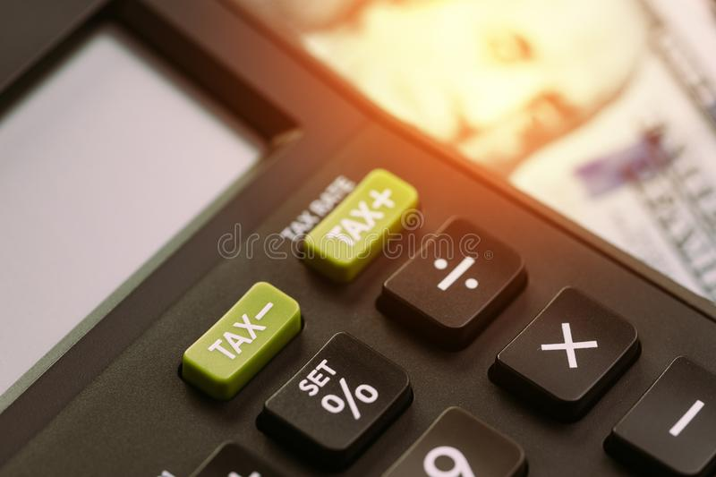 Tax cuts or reduce concept, selective focus on TAX minus buttons stock images