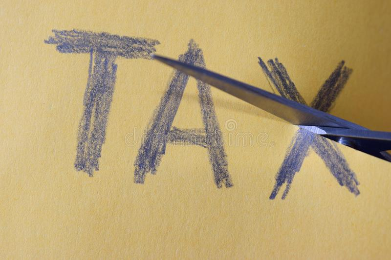 Tax Deduction - Scissors cut taxes stock photography