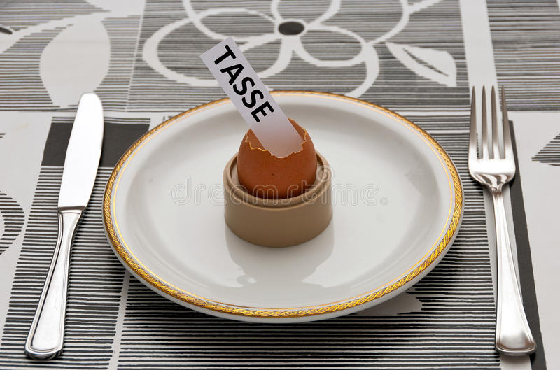 Tax in the Easter Egg. Bad surprise of taxes in the Easter Egg. Brutta sorpresa per Pasqua: tasse stock photo
