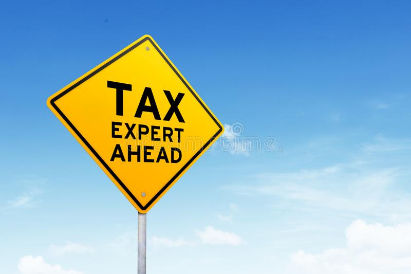 Tax expert road sign shot over beautiful blue sky. Tax expert road sign over blue sky. Tax day concept stock photos