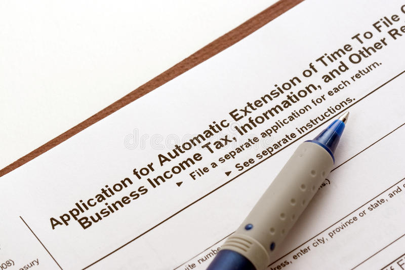 Tax Extension Application. An application for a US business income tax extension of time to file stock photo