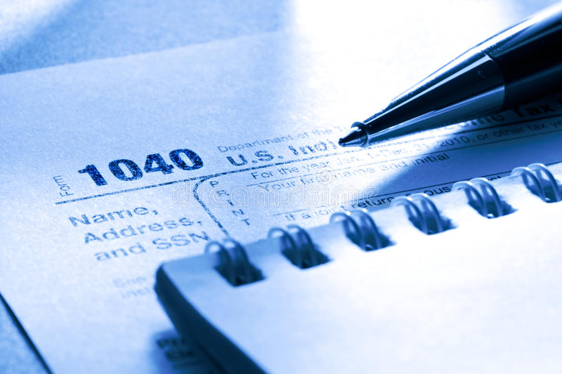Tax form. Pen and notepad royalty free stock photo