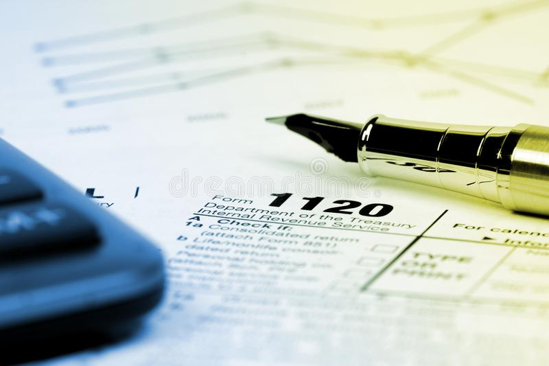 Tax form 1120 with calculator royalty free stock image