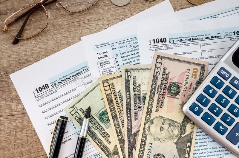 1040 Tax form, dollar and calculator. 1040 Tax form, dollar and calculator royalty free stock images