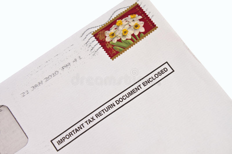 Tax form in envelope. Envelope with tax form and stamp isolated royalty free stock photo