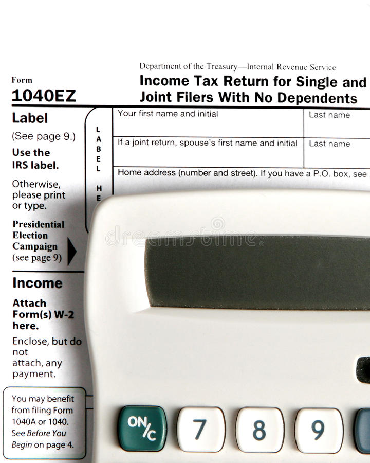 Tax Form EZ With Calculator Royalty Free Stock Image