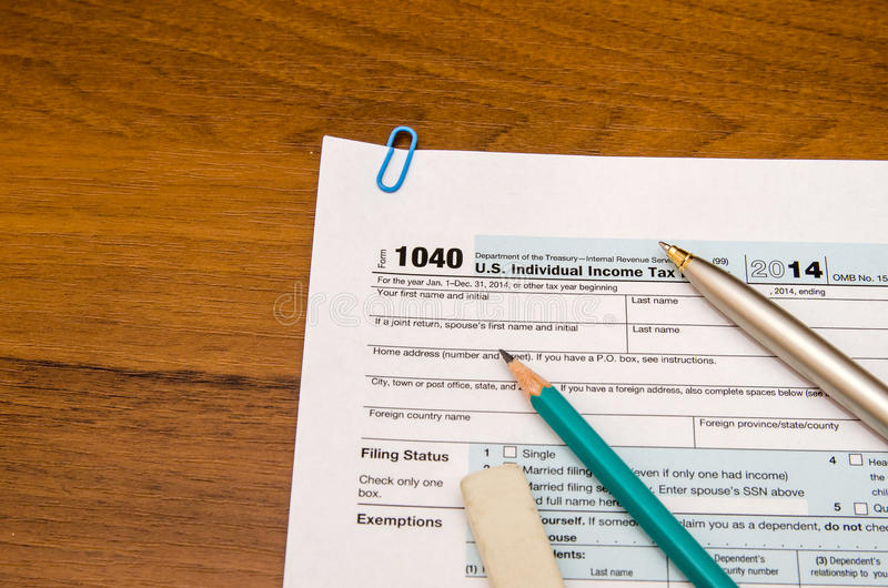 1040 tax form. Filling US individual tax return form 1040 in table royalty free stock images