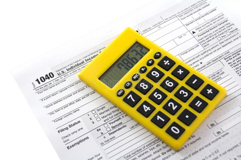 Tax form 1040. Filling in tax form 1040 , USA stock image