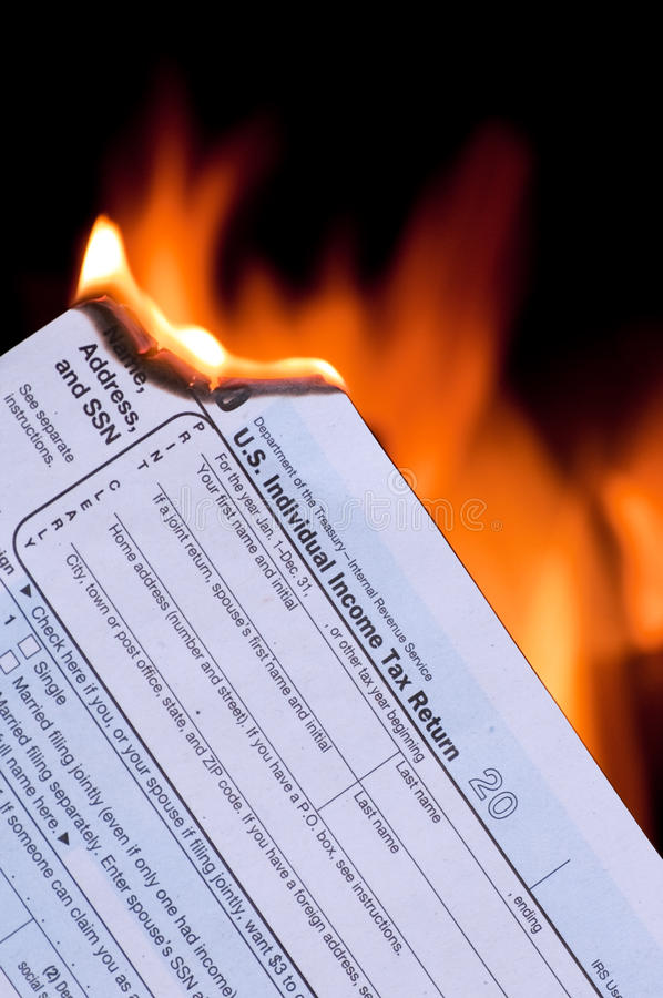 Download Tax form on fire stock photo. Image of burn, deduction - 18775052