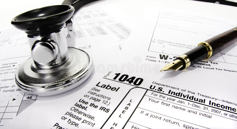 Tax Form with Stethoscope stock photo