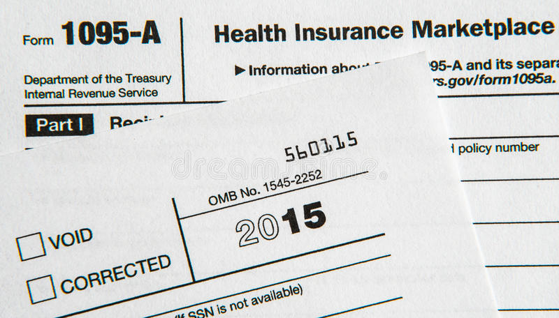 Tax forms for Affordable Health Care Act. Internal Revenue Service Form 1095 for Obamacare stock photo