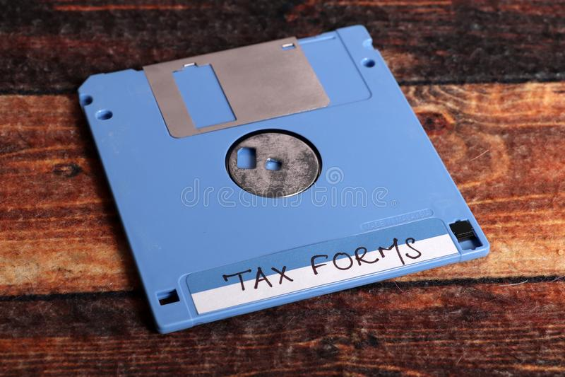 Tax forms. Beautiful shot of floppy disks with tax forms in it stock photos
