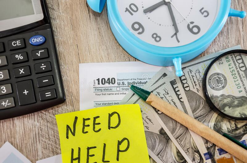 Tax forms 1040, calculator, dollars, alarm clock on the table. Tax forms 1040, calculator, dollars, alarm clock royalty free stock images