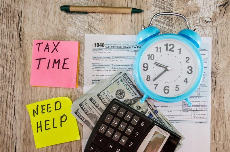 Tax forms 1040, calculator, dollars, alarm clock on the table. Tax forms 1040, calculator, dollars, alarm clock royalty free stock photography