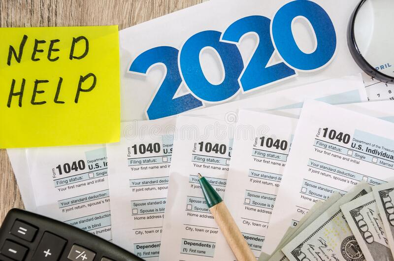 Tax forms 1040, calculator, dollars and pen on the table. Tax forms 1040, calculator, dollars and pen stock photography