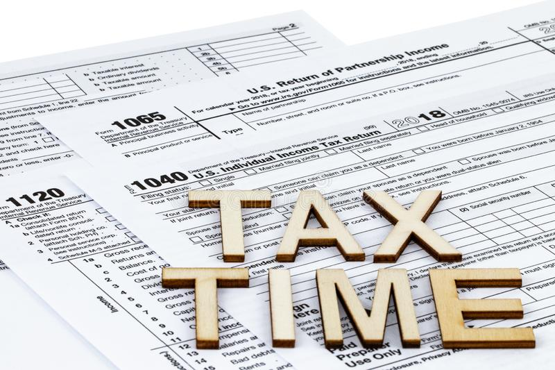 The tax forms 1040,1120,1065. Tax Day concept. The tax forms 1040,1120,1065. The Tax Day concept stock photos