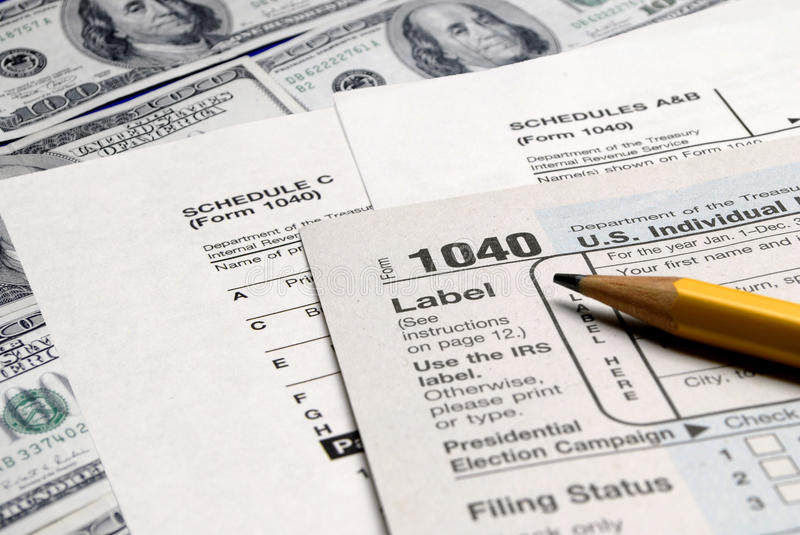 Tax Forms on top of Money royalty free stock photos