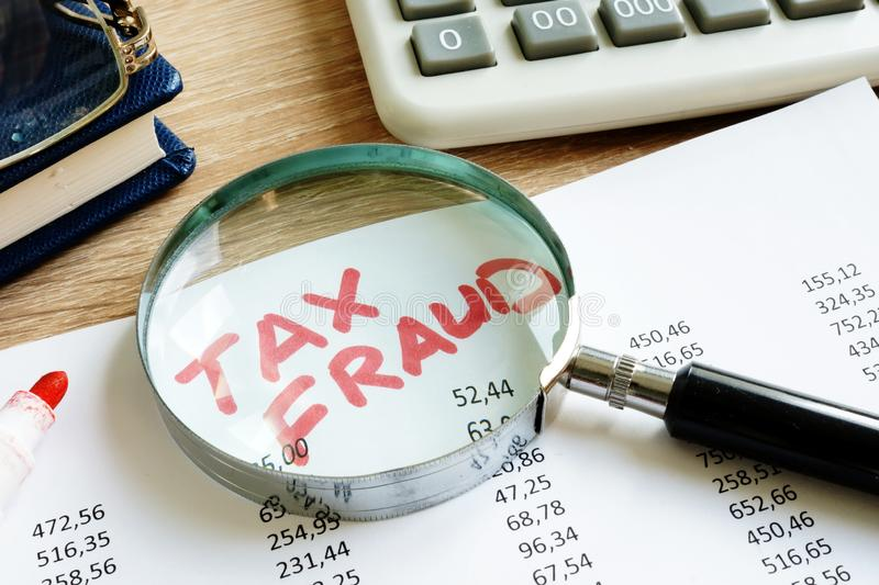 Tax fraud written on the audit report. royalty free stock images