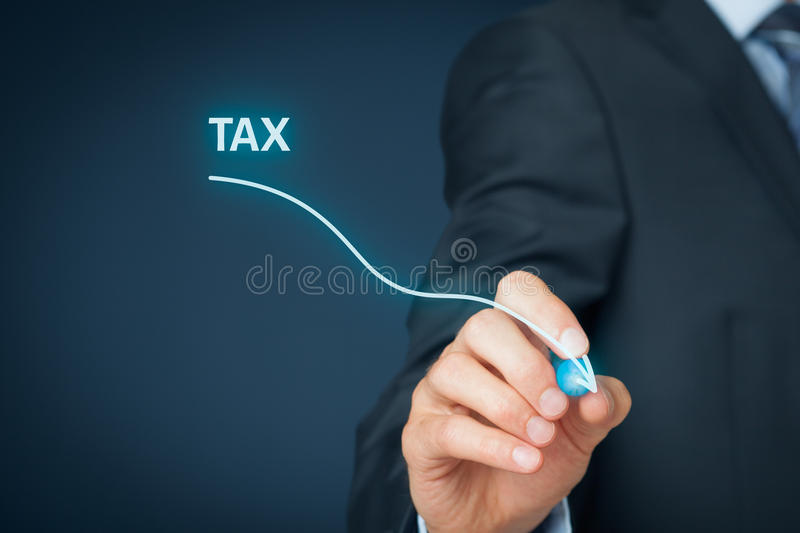 Tax optimization. Business concept. Businessman draw simple graph with descending curve royalty free stock photo