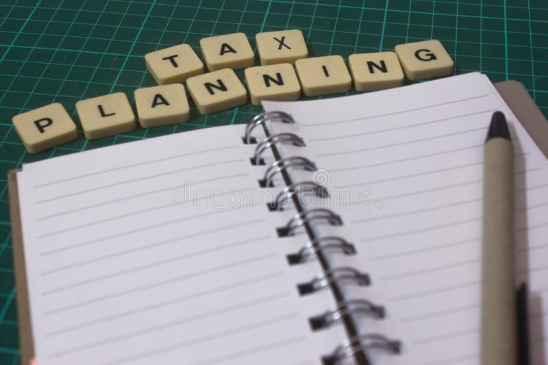 Tax planning on book. Report of tax planning daily on book stock image
