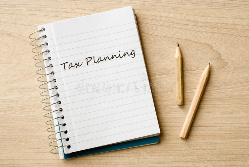 Tax planning. On notebook on desk stock photography