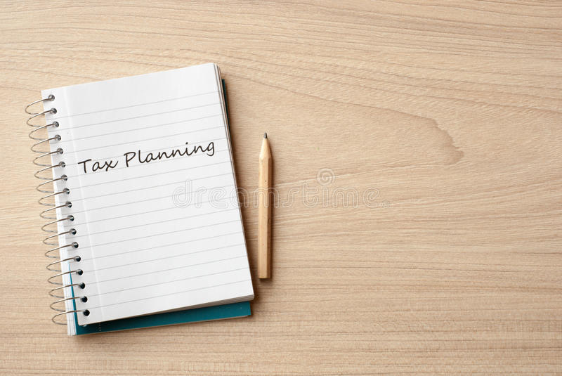 Tax planning. On notebook on desk stock photo