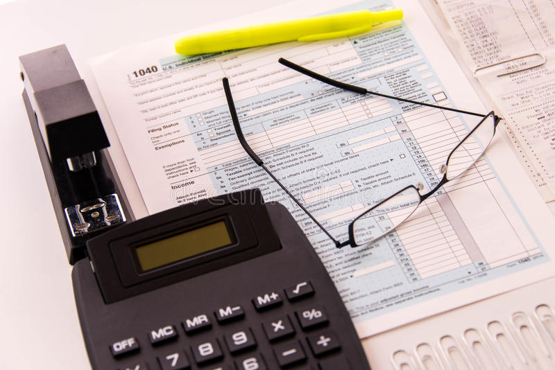 Tax preparation supplies, reading glasses and tax forms royalty free stock images