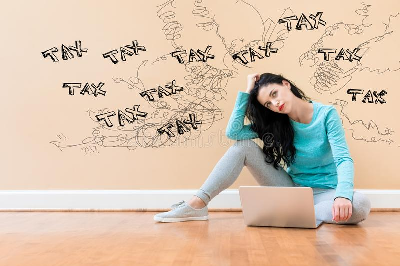 Tax problem theme with woman using a laptop royalty free stock images