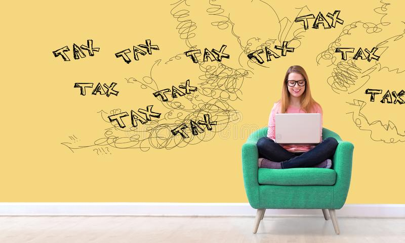 Tax problem theme with woman using a laptop stock photography