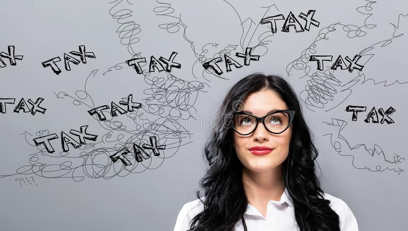 Tax problem theme with young businesswoman stock images