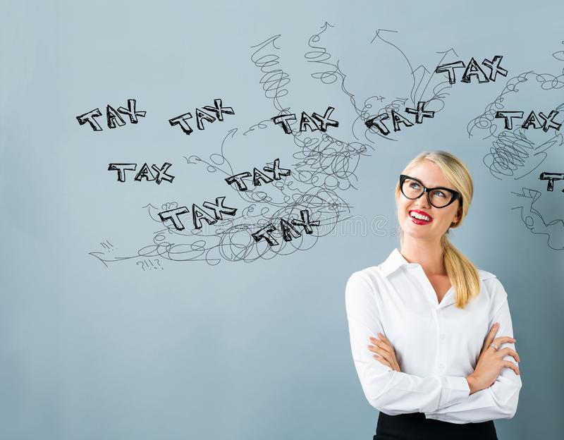Tax problem theme with young woman stock images
