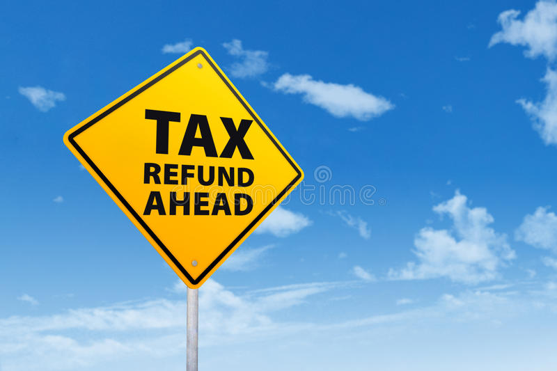 Tax Refund Ahead. Tax refund concept with a road sign under blue sky stock photo