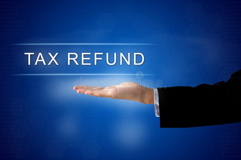 Tax refund button on virtual screen. Tax refund button with business hand on a touch screen interface royalty free stock photo