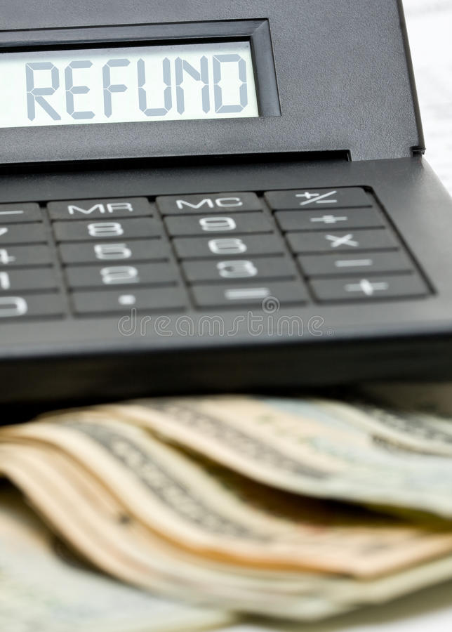 Tax refund calculation. Bank notes with calculator - tax refund concept stock photo