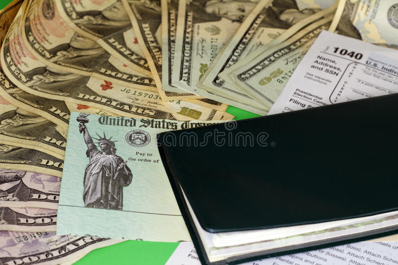 Download Tax Refund Check With Money And Checkbook Editorial Photography - Image of 1040, assets: 91107902
