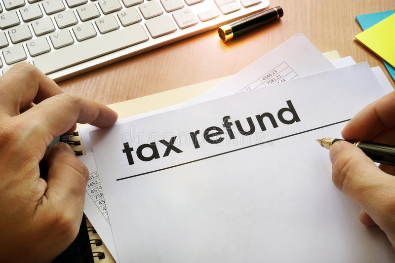 Tax refund. Hands holding documents with title tax refund royalty free stock images