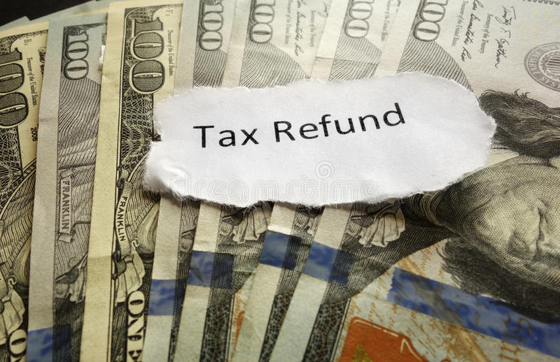 Tax Refund. Paper text on assorted cash stock images