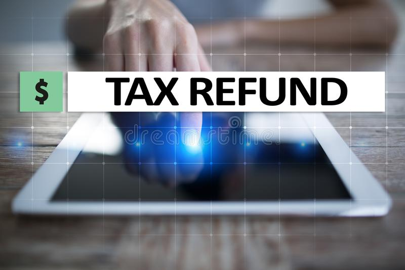 Tax refund text on virtual screen. Business and Finance concept. Tax refund text on virtual screen. Business and Finance concept royalty free stock images