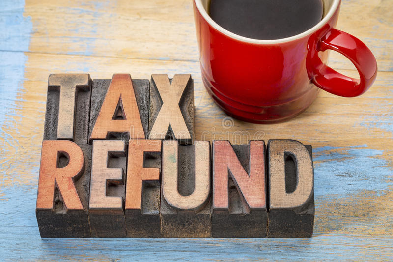 Tax refund in wood type. Tax refund - word abstract in vintage letterpress wood type blocks with a cup of coffee stock photo